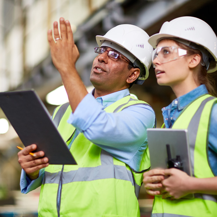 male and female in manufacturing business