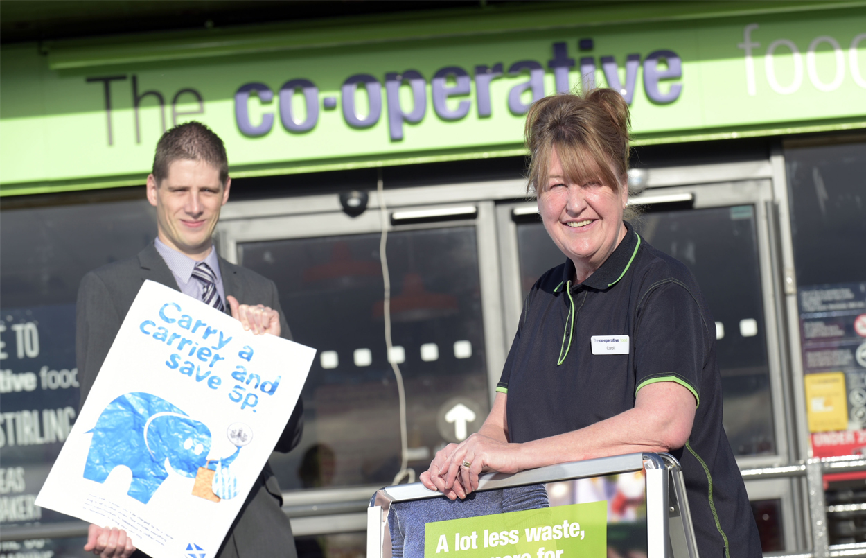David Barnes from Zero Waste Scotland with Carol from The Co-Operative branch in Stirling at last year's launch of the carrier bag charge